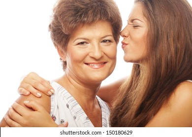 beautiful mature mother and daughter smiling