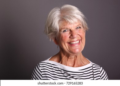 Beautiful Mature woman in front of a dark background
