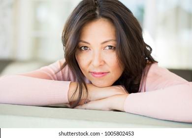 Beautiful mature woman looking at the camera.