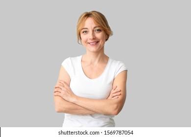 Beautiful mature woman on light background