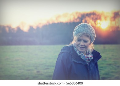 Beautiful mature woman out walking in the countryside