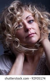 Beautiful mature woman portrait - feeling good expression