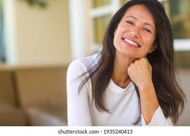 Beautiful mature woman sitting on the sofa