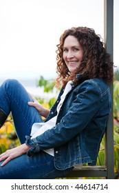 A beautiful mature woman sitting outdoor