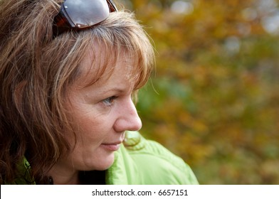 Beautiful mature women in a autumnal scenery