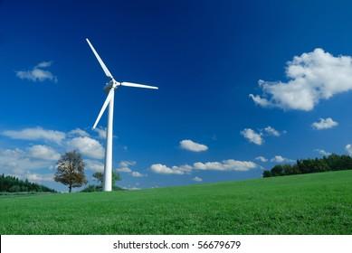 Beautiful meadow with one wind turbine, panorama