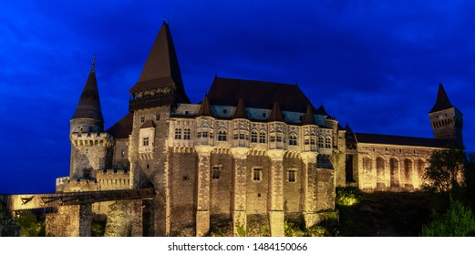 The beautiful Medieval Corvin Castle in Romania at night panorama
