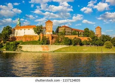 beautiful medieval european castle near river waterfront old city district and space for walking concept shot in bright colorful contrast summer day time without people on blue sky background