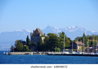 The beautiful medieval garden town of Yvoire, France on Lac Leman with Chateau d'Yvoire and the Alps as the background