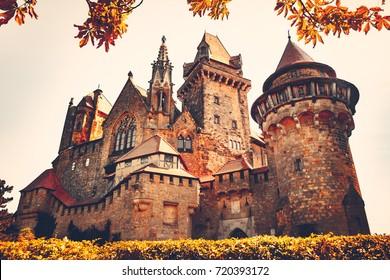 Beautiful medieval Kreuzenstein castle in Leobendorf village neat Vienna, Austria, Europe. Autumn season. Vintage retro filter. Orange toning