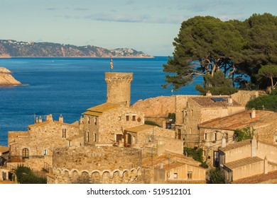 The beautiful medieval town of Tossa de Mar, a perfectly preserved walled fort and city complex set the gorgeous rugged Costa Brava Coast north of Barcelona, Catalonia, Spain