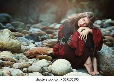 Beautiful medieval woman with dreaming expression . Historical and fantasy