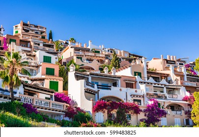 Beautiful mediterranean buildings at the coast of Majorca island, small town of Cala Fornells, Spain Balearic Islands.