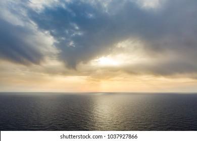 A beautiful Mediterranean cloudy sunset over calm seas