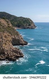 Beautiful Mediterranean coastline, pure blue, mountains with green trees, from the heights, waves crashing against the shore