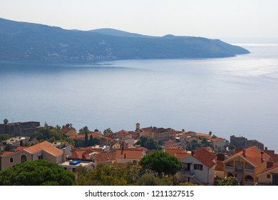 Beautiful Mediterranean landscape. Montenegro, Adriatic Sea. View of Bay of Kotor, Lustica peninsula and red roofs of seaside town of Herceg Novi
