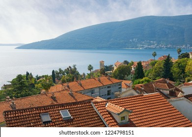 Beautiful Mediterranean landscape. Montenegro, Adriatic Sea. View of Bay of Kotor and red roofs of ancient town of Herceg Novi