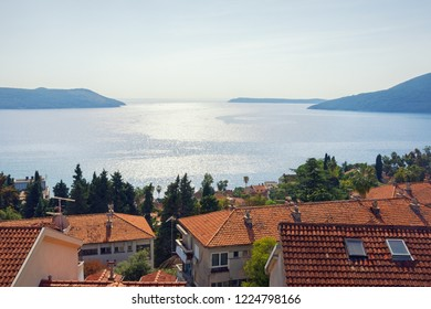 Beautiful Mediterranean landscape. Montenegro, Adriatic Sea. View of Bay of Kotor and red roofs of seaside town of Herceg Novi