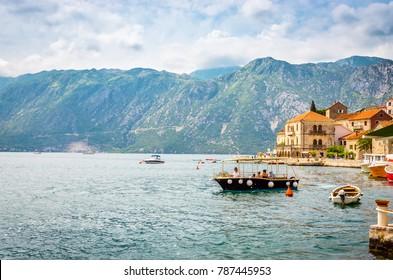 beautiful mediterranean landscape. Mountains and fishing boats near town Perast, Kotor bay (Boka Kotorska), Montenegro.