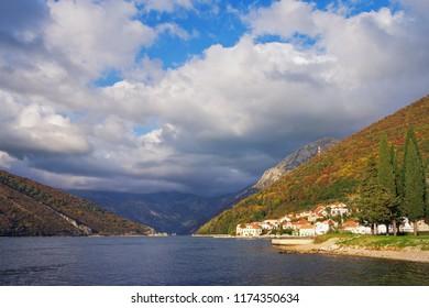 Beautiful Mediterranean landscape on sunny autumn day. Montenegro,  Bay of Kotor, Verige Strait, Lepetane village