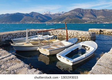 Beautiful Mediterranean landscape on sunny winter day. Fishing boats in small harbor.  Montenegro, Adriatic Sea. View of Bay of  Kotor near Tivat city