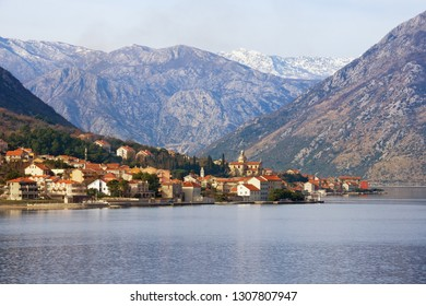 Beautiful Mediterranean landscape on winter day. Montenegro, Adriatic Sea, Bay of Kotor, view of Prcanj town