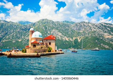 Beautiful mediterranean landscape. Our Lady of the Rock Island near town Perast, Kotor bay, Montenegro.