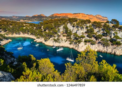 Beautiful mediterranean travel destination, Calanques de Port Pin bay with luxury yachts harbor and sailing boats, Calanques National Park, Cassis resort, Provence, France, Europe