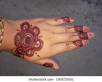 A beautiful mehandi art on hand of a Nepali girl