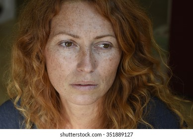 beautiful melancholic woman without makeup looking away thinking about problems