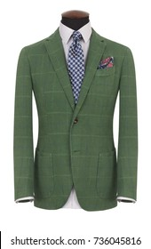 Beautiful men's green jacket suit with shirt and tie on a mannequin isolated on white background