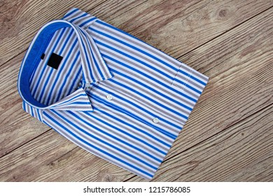 Beautiful Mens Shirt with stripes on wooden Background