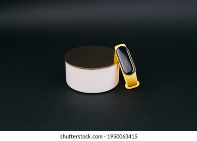 A beautiful metal can for storing a fitness bracelet.