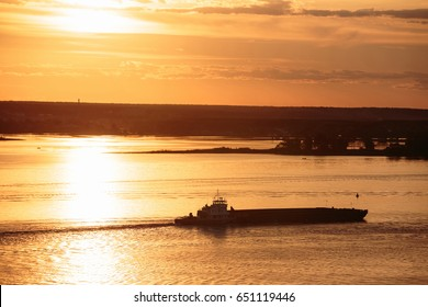Beautiful metal ship silhouette on river at summer evening