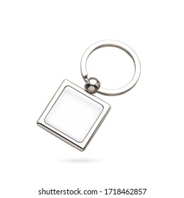 Beautiful metal square keychain with silver key ring and logo placeholder with domed label. Keychain isolated background. Dome label keychain.