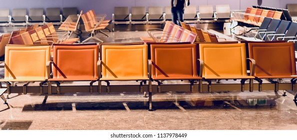 Beautiful metallic chairs for the passengers inside an airport unique photo