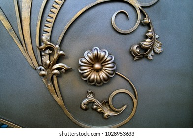 beautiful metallic flower and leaves on a metal gate