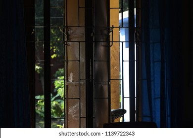A beautiful metallic window grill of a room isolated unique photograph