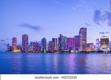 Beautiful Miami Florida skyline with lights and bay at sunset