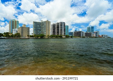 Beautiful Miami skyline along Biscayne Bay from Key Biscayne with tall Brickell Avenue condos in the background.