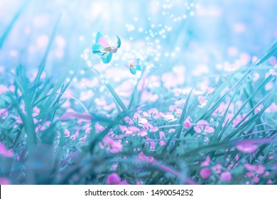 Beautiful micro Veronica persica wildflowers, butterfly in the dreamy meadow. Delicate pink and blue colors pastel toned. Shallow depth macro background. Nature floral springtime.