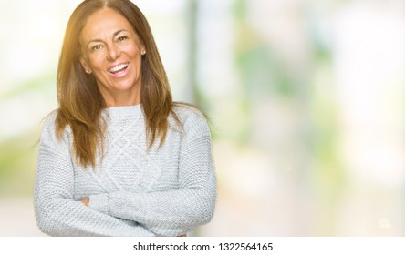 Beautiful middle age adult woman wearing winter sweater over isolated background happy face smiling with crossed arms looking at the camera. Positive person.