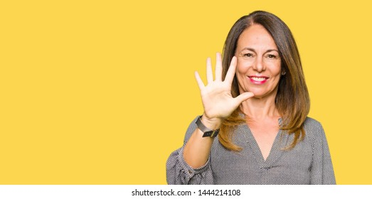 Beautiful middle age business woman showing and pointing up with fingers number five while smiling confident and happy.