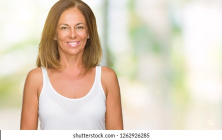 Beautiful middle age casual adult woman over isolated background with a happy and cool smile on face. Lucky person.