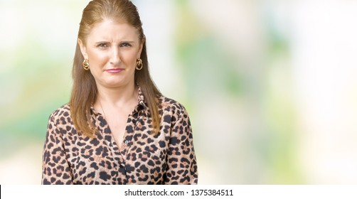 Beautiful middle age mature rich woman wearing leopard dress over isolated background skeptic and nervous, frowning upset because of problem. Negative person.