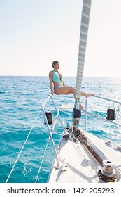 Beautiful middle age sexy woman in classy swimwear on private luxury sailing yacht, sunny outdoors. Beauty elegant female on exclusive summer vacation, leisure recreation aspirational lifestyle.