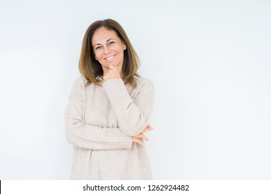 Beautiful middle age woman over isolated background looking confident at the camera with smile with crossed arms and hand raised on chin. Thinking positive.