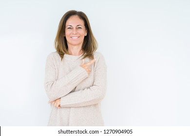 Beautiful middle age woman over isolated background cheerful with a smile of face pointing with hand and finger up to the side with happy and natural expression on face