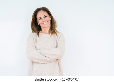 Beautiful middle age woman over isolated background happy face smiling with crossed arms looking at the camera. Positive person.