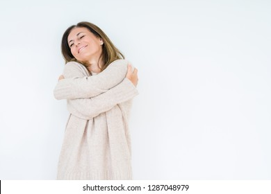 Beautiful middle age woman over isolated background Hugging oneself happy and positive, smiling confident. Self love and self care
